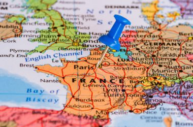 France pinned on a map with blue thumb tack.