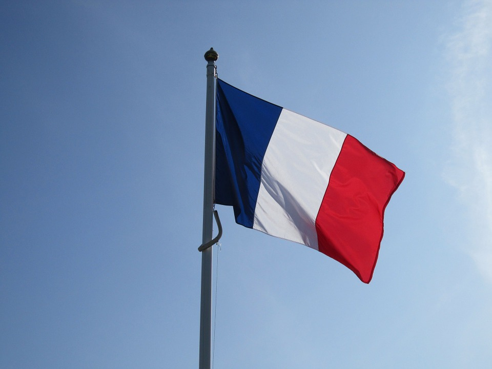 National French flag on a flag pole.