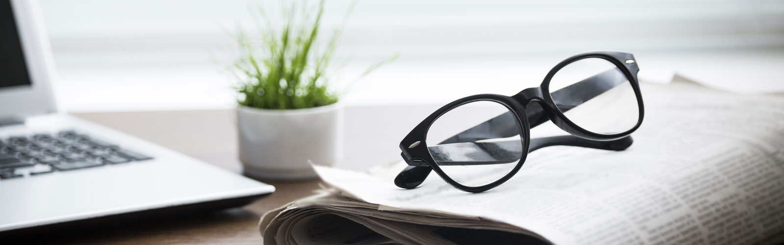 Glasses laying on newspaper