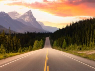 Colorful sunset while driving in Canadian Rockies